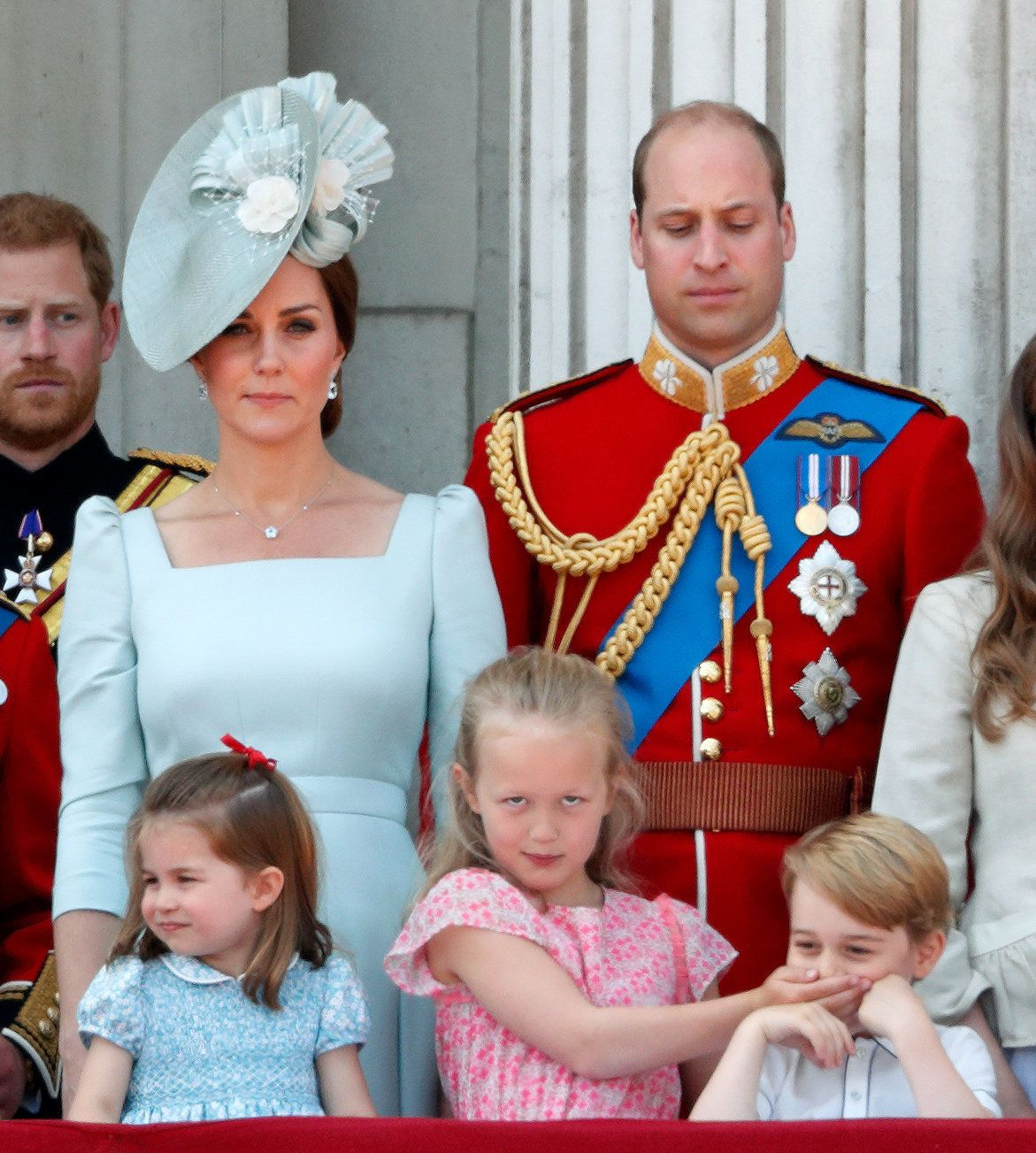 LONDON, UNITED KINGDOM - JUNE 09: (EMBARGOED FOR PUBLICATION IN UK NEWSPAPERS UNTIL 24 HOURS AFTER CREATE DATE AND TIME) Catherine, Duchess of Cambridge, Princess Charlotte of Cambridge, Prince William, Duke of Cambridge and Savannah Phillips (with her hand over Prince George of Cambridge's mouth) stand on the balcony of Buckingham Palace during Trooping The Colour 2018 on June 9, 2018 in London, England. The annual ceremony, involving over 1400 guardsmen and cavalry, is believed to have first been performed during the reign of King Charles II. The parade marks the official birthday of the Sovereign, even though the Queen's actual birthday is on April 21st. (Photo by Max Mumby/Indigo/Getty Images)