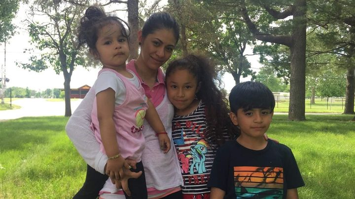 Julieta holds her nieces, Frida, 2, and Estrella, 8, and her son, Josue, 6, in Mount Pleasant, Iowa. The children's fathers w