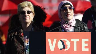 LAS VEGAS, NV - JANUARY 21:  Clark County Commissioner and 2018 Nevada gubernatorial candidate Chris Giunchigliani (L) is introduced by Women's March Co-Chairwoman Linda Sarsour during the Women's March 'Power to the Polls' voter registration tour launch at Sam Boyd Stadium on January 21, 2018 in Las Vegas, Nevada. Demonstrators across the nation gathered over the weekend, one year after the historic Women's March on Washington, D.C., to protest President Donald Trump's administration and to raise awareness for women's issues.  (Photo by Ethan Miller/Getty Images)