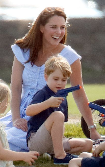 Catherine, Duchess of Cambridge looks on as Prince George of Cambridge plays with a toy gun whilst attending the Maserati Royal Charity Polo Trophy at the Beaufort Polo Club on 10 June 2018 in Gloucester, England.