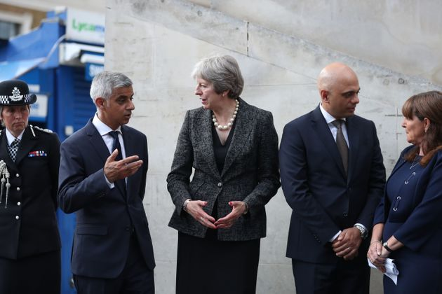 Prime Minister Theresa May, (C), Mayor of London Sadiq Khan, (L), and Home Secretary Sajid Javid