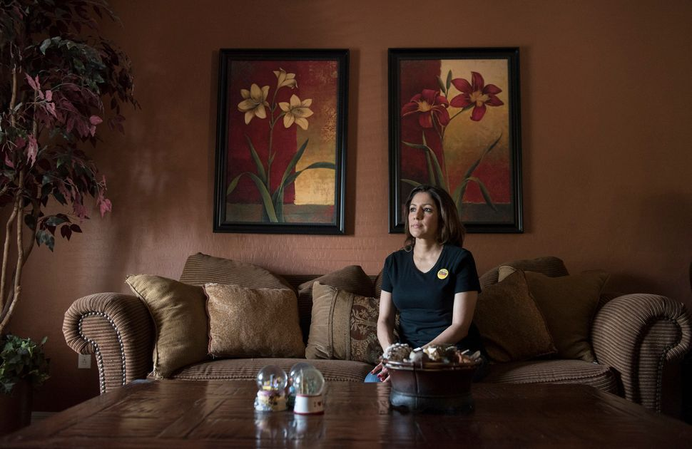 Claudia Ramos, a guest room attendant at the Paris, at her home in Las Vegas. Ramos has taken leaves of absence from her job