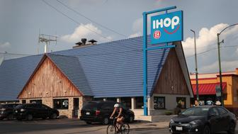 CHICAGO, IL - AUGUST 10:  An IHOP restaurant serves customers on August 10, 2017 in Chicago, Illinois. DineEquity, the parent company of Applebee's and IHOP, plans to close up to 160 restaurants in the first quarter of 2018. The announcement helped the stock climb more than 4 percent today.  (Photo by Scott Olson/Getty Images)