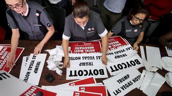 LAS VEGAS, NV - OCTOBER 18:  Trump International Las Vegas employees and members of the Culinary Workers Union Local 226 (L-R) Guadalupe Barba, Ivelice Martinez and Lourdes Rivera assemble picket signs at their union headquarters October 18, 2016 in Las Vegas, Nevada. The union members and their supporters will carry the signs as they march in front of the hotel the same day that Republican presidential nominee Donald Trump will debate Democratic presidential nominee Hillary Clinton at the University of Nevada Las Vegas.  (Photo by Chip Somodevilla/Getty Images)