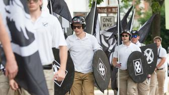 DOWNTOWN, CHARLOTTESVILLE, VIRGINIA, UNITED STATES - 2017/08/12: Neo-Nazis, white supremacists and other alt-right factions scuffled with counter-demonstrators near Emancipation Park (Formerly 'Lee Park') in downtown Charlottesville, Virginia. After fighting between factions escalated, Virginia State Police ordered the evacuation by all parties and cancellation of the 'Unite The Right' rally scheduled to take place in the park. (Photo by Albin Lohr-Jones/Pacific Press/LightRocket via Getty Images)
