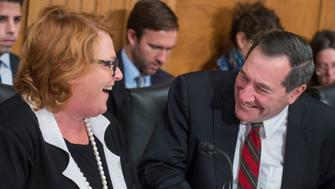 UNITED STATES - NOVEMBER 01: Sens. Joe Donnelly, D-Ind., and Heidi Heitkamp, D-N.D., attend a Senate Banking, Housing and Urban Affairs Committee hearing in Dirksen Building on Export-Import Bank nominations on November 1, 2017. (Photo By Tom Williams/CQ Roll Call)