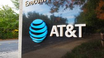Sign with logo at the regional headquarters of telecommunications company ATT in the Bishop Ranch office park in San Ramon, California, October 20, 2017. (Photo by Smith Collection/Gado/Getty Images)