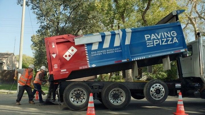 "Domino's is offering to fill ""cracks, bumps and potholes"" to smooth road conditions. The initiative is aimed at ""saving"