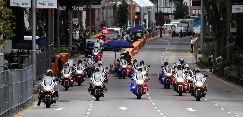 Motorcycles lead Kim's motorcade on its way to Sentosa.