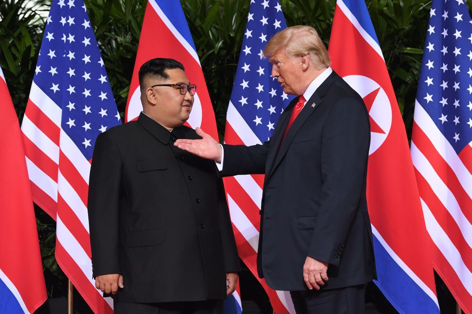 U.S. President Donald Trump gestures as he meets with North Korean leader Kim Jong Un at the start of their historic U.S.-Nor