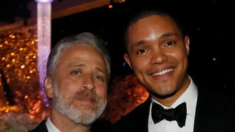 Television personality Jon Stewart (L) poses with actor Trevor Noah at the 67th Annual Primetime Emmy Awards Governors Ball in Los Angeles, California September 20, 2015.  REUTERS/Mario Anzuoni