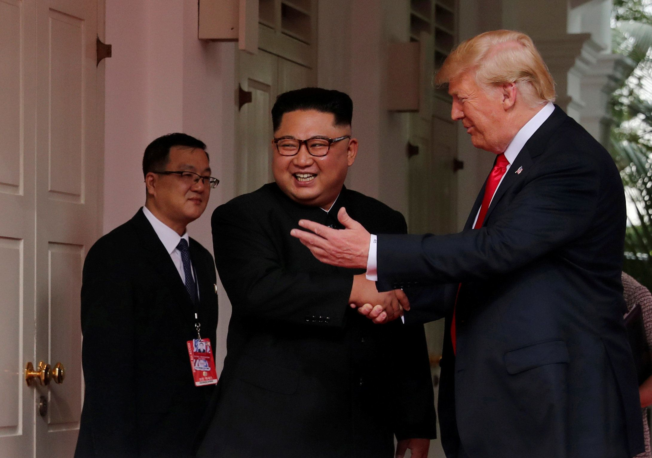 Kim, Trump Shake Hands At Historic Summit
