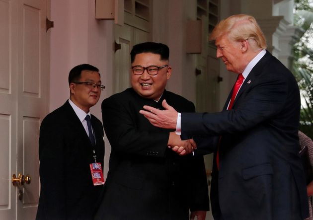U.S. President Donald Trump shakes hands with North Korea's leader Kim Jong Un at the Capella Hotel on...