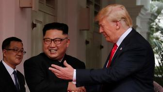 U.S. President Donald Trump shakes hands with North Korea's leader Kim Jong Un at the Capella Hotel on Sentosa island in Singapore June 12, 2018. REUTERS/Jonathan Ernst