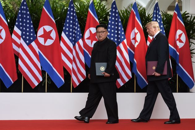 Kim and Trump walk the red