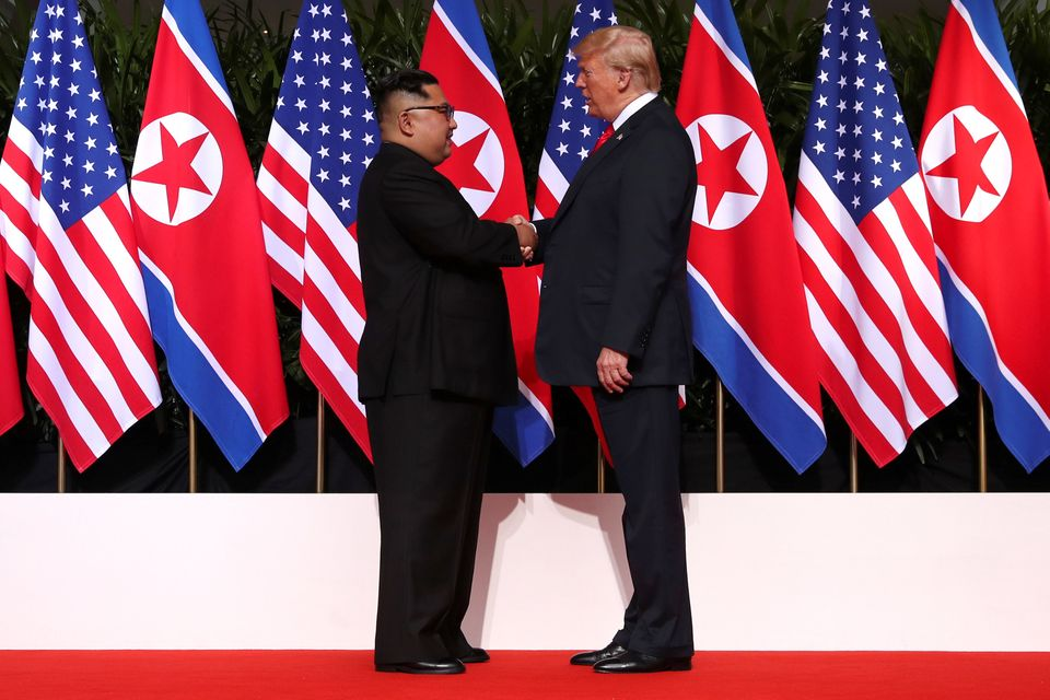 Meeting in the middle: US President Donald Trump and North Korea's leader Kim Jong Un symbolically shake...