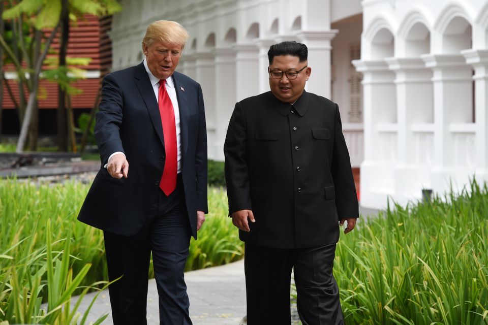 During a stroll without their interpreters, Trump resorted to pointing out foliage to the North...