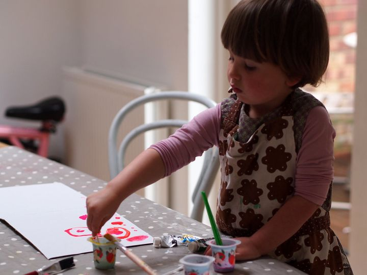 Elfie makes cards for her dad and sometimes collaborates with her parents to make cards for her granddads too.