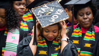 CAMBRIDGE, MA - MAY 23: A graduate adjusts her cap as she takes part in the Black Commencement at Harvard University in Cambridge, Mass., on May 23, 2017. One hundred seventy students attended the university-wide ceremony for black students at Harvard, designed to celebrate their unique struggles and achievements at the elite institution that has been grappling with its historical ties to slavery. (Photo by Keith Bedford/The Boston Globe via Getty Images)