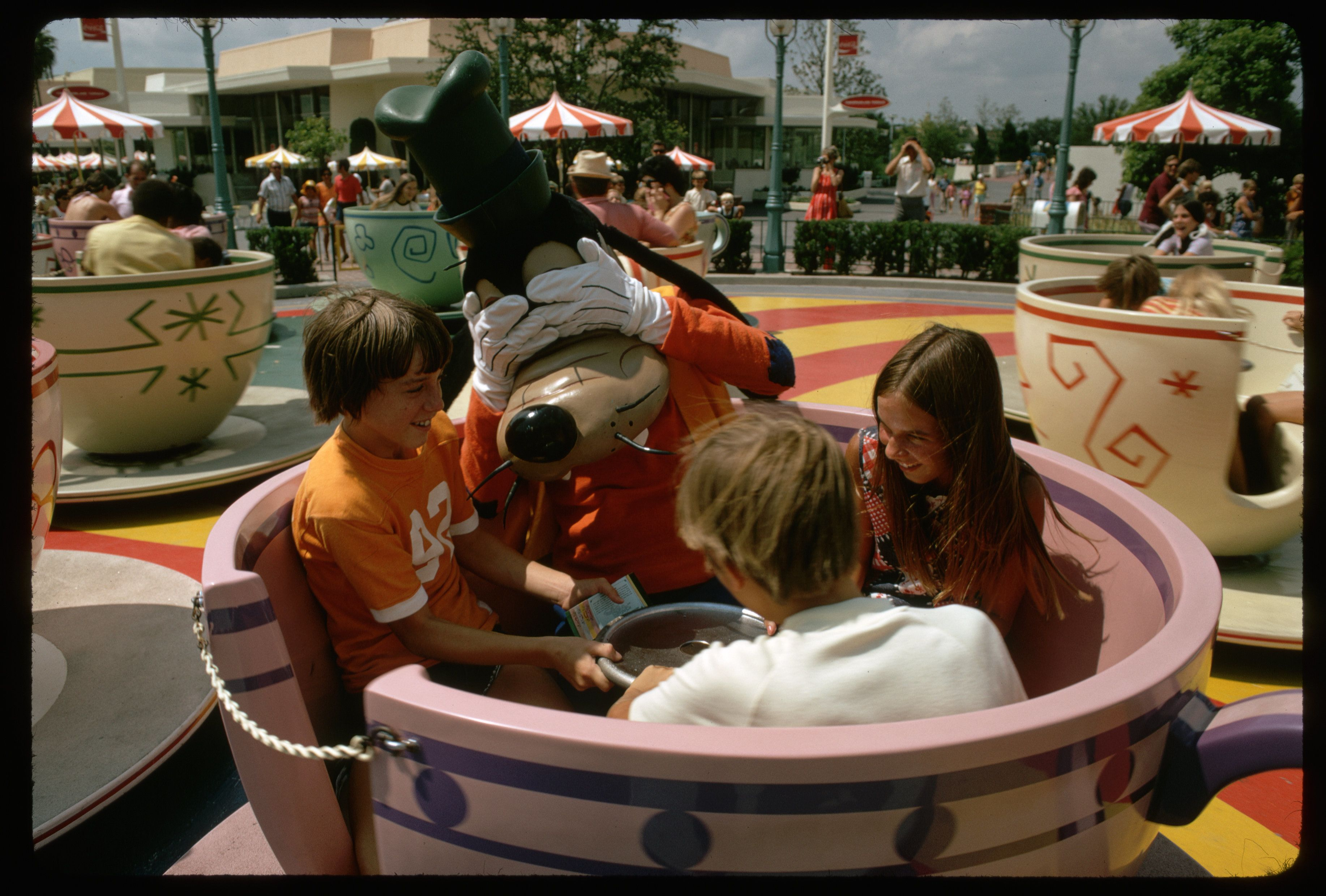Children and Goofy on Mad Tea Party Ride (Photo by Jonathan Blair/Corbis via Getty Images)
