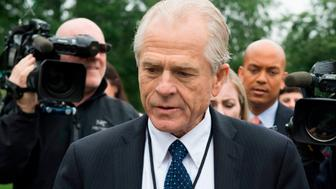 White House Director of Trade Policy Peter Navarro (C) dodges the press after speaking on Fox News at the White House in Washington, DC, on June 4, 2018. (Photo by JIM WATSON / AFP)        (Photo credit should read JIM WATSON/AFP/Getty Images)