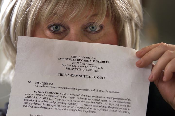 Mia Finn, 51, shows the eviction notice she received from the landlord. She is a flight attendant from San Juan Capistrano wh