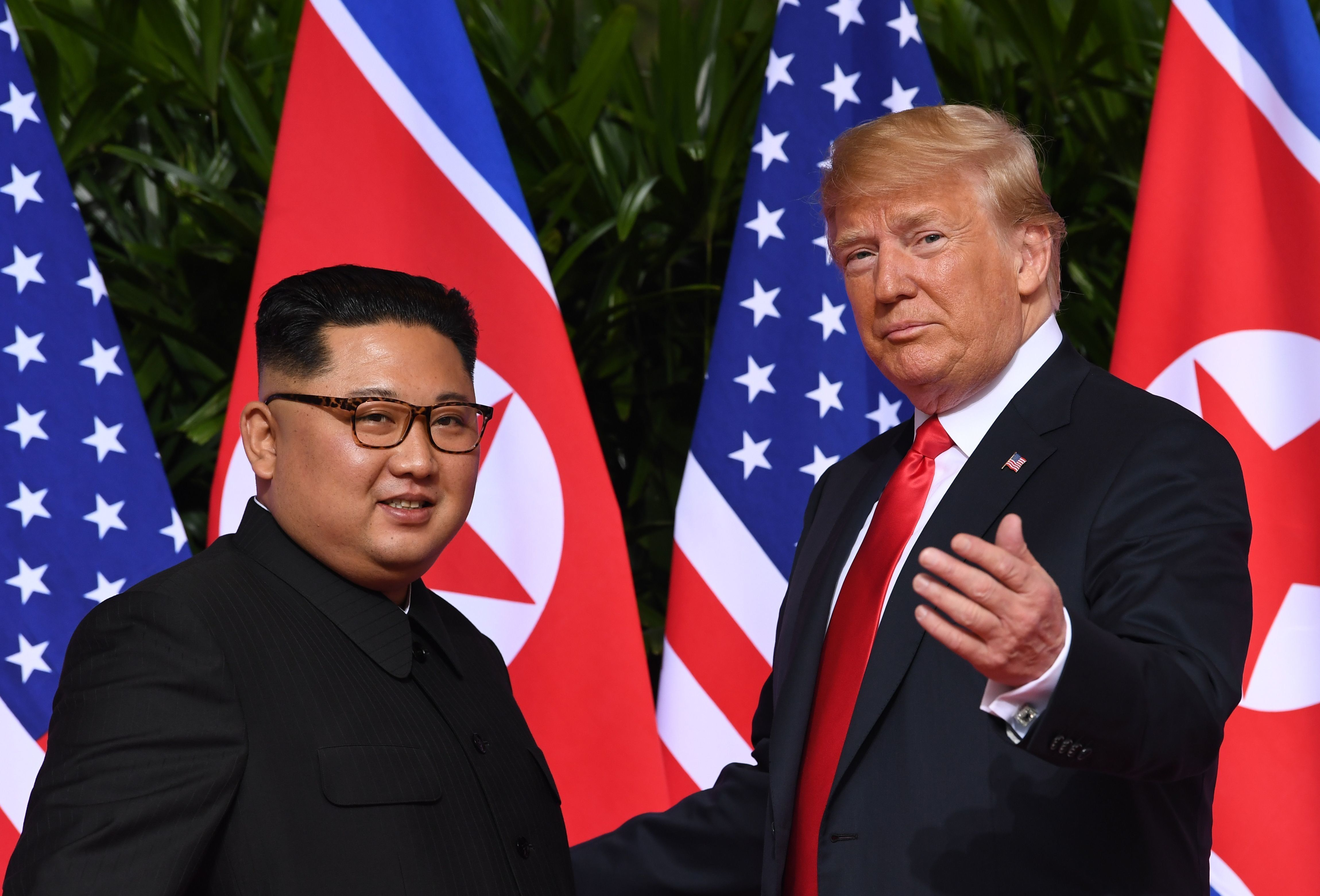 North Korea's leader Kim Jong Un and U.S. President Donald Trump at the start of their summit in Singapore