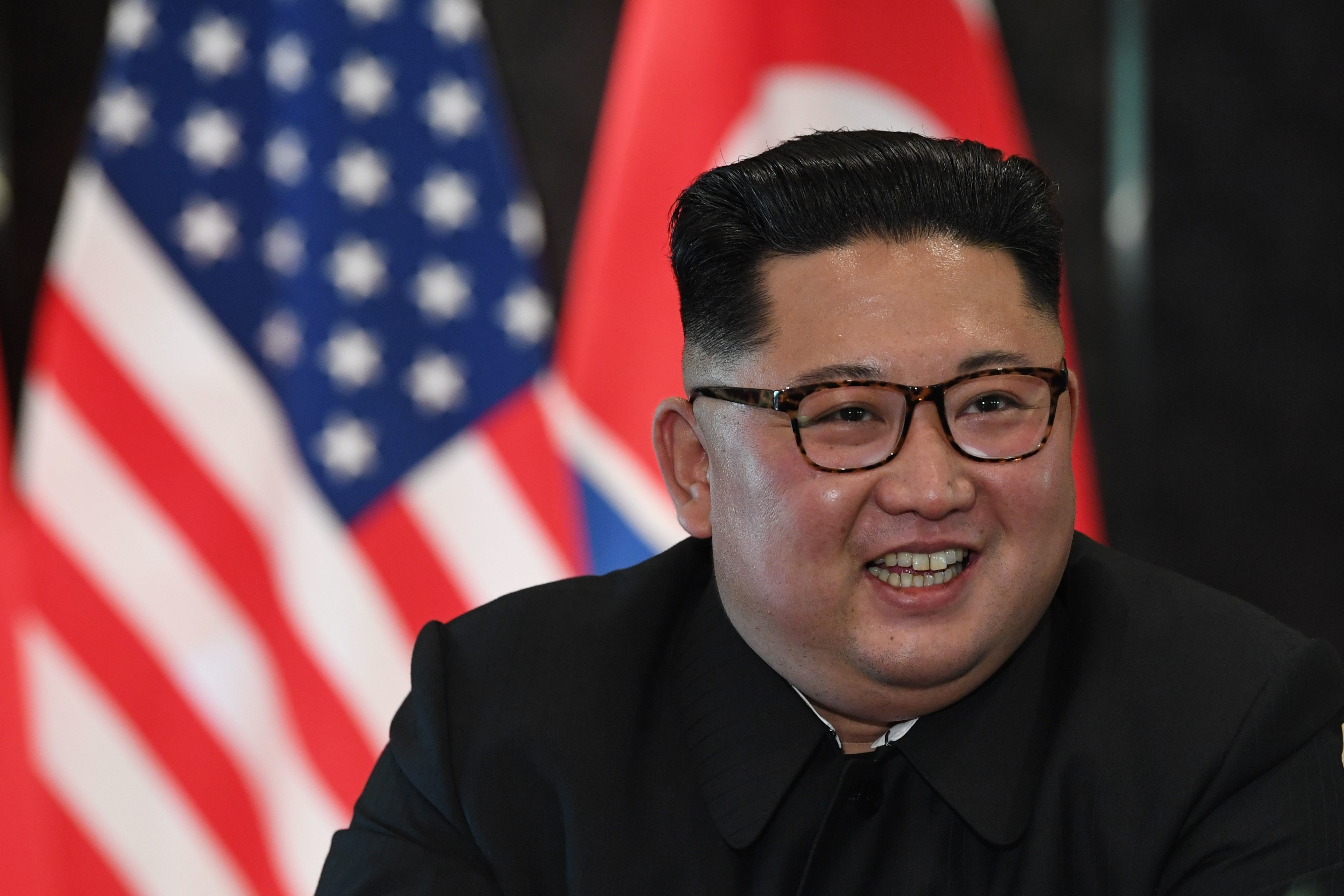 North Korea's leader Kim Jong Un reacts at a signing ceremony with US President Donald Trump (not pictured) during their historic US-North Korea summit, at the Capella Hotel on Sentosa island in Singapore on June 12, 2018. - Donald Trump and Kim Jong Un became on June 12 the first sitting US and North Korean leaders to meet, shake hands and negotiate to end a decades-old nuclear stand-off. (Photo by SAUL LOEB / AFP)        (Photo credit should read SAUL LOEB/AFP/Getty Images)