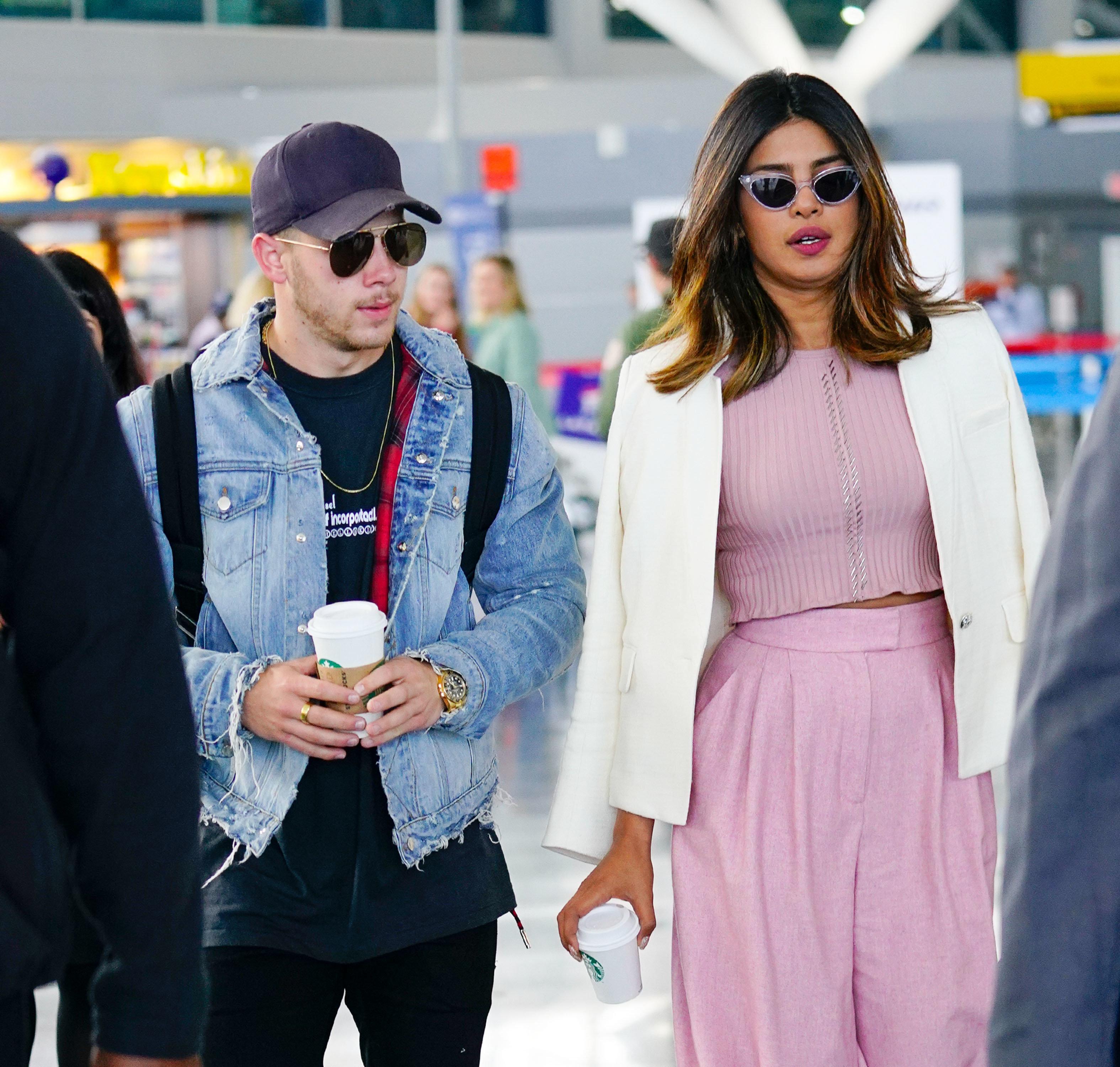 NEW YORK, NY - JUNE 08:  Nick Jonas and Priyanka Chopra at JFK airport on June 8, 2018 in New York City.  (Photo by Gotham/GC Images)