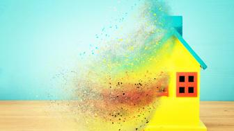 Image of wooden colorful house model. Real estate and uncertainty concept