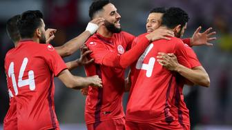 Tunisia's forward Anice Badri (2nd R) celebrates after scoring his team's second goal during the friendly football match between Tunisia and Turkey at the Stade de Geneve stadium in Geneva on June 1, 2018. (Photo by Fabrice COFFRINI / AFP)        (Photo credit should read FABRICE COFFRINI/AFP/Getty Images)