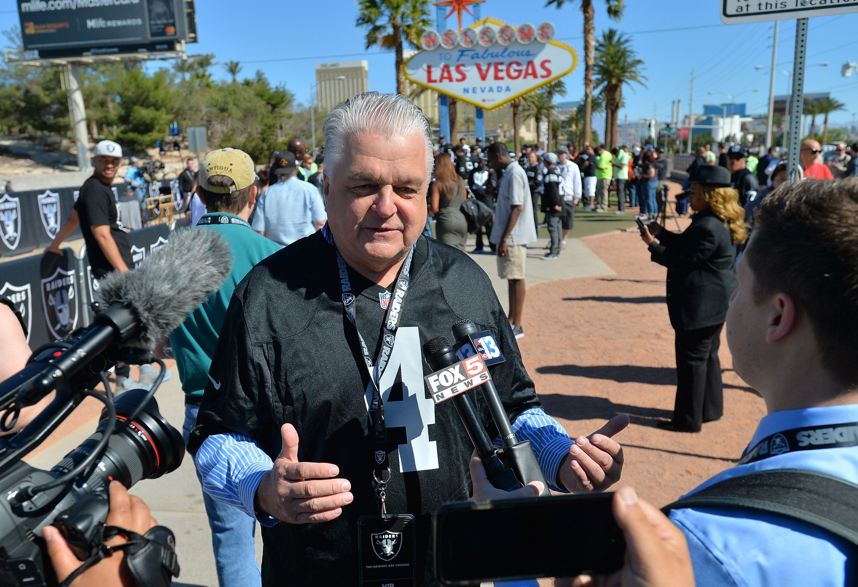LAS VEGAS, NV - APRIL 29:  Clark County Commissioner Steve Sisolak is interviewed during the Oakland Raiders 2017 NFL Draft event at the Welcome to Fabulous Las Vegas sign on April 29, 2017 in Las Vegas, Nevada. National Football League owners voted in March to approve the team's application to relocate to Las Vegas. The Raiders are expected to begin play no later than 2020 in a planned 65,000-seat domed stadium to be built in Las Vegas at a cost of about USD 1.9 billion.  (Photo by Sam Wasson/Getty Images)
