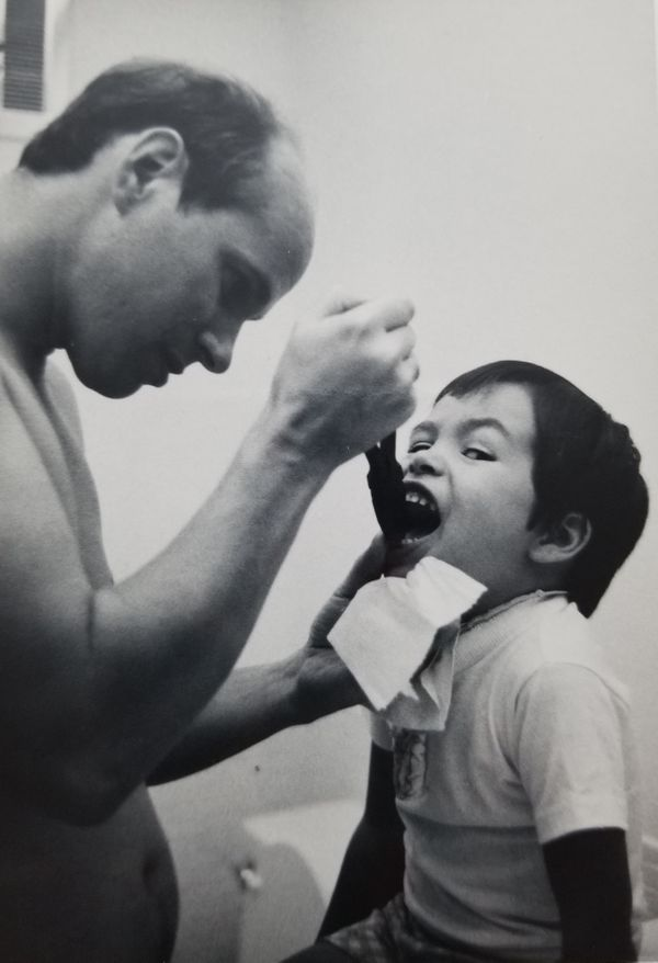 """My handyman father, Paul, helping me remove my first loose tooth in 1977. I was 5 and had been wiggling it for weeks to"
