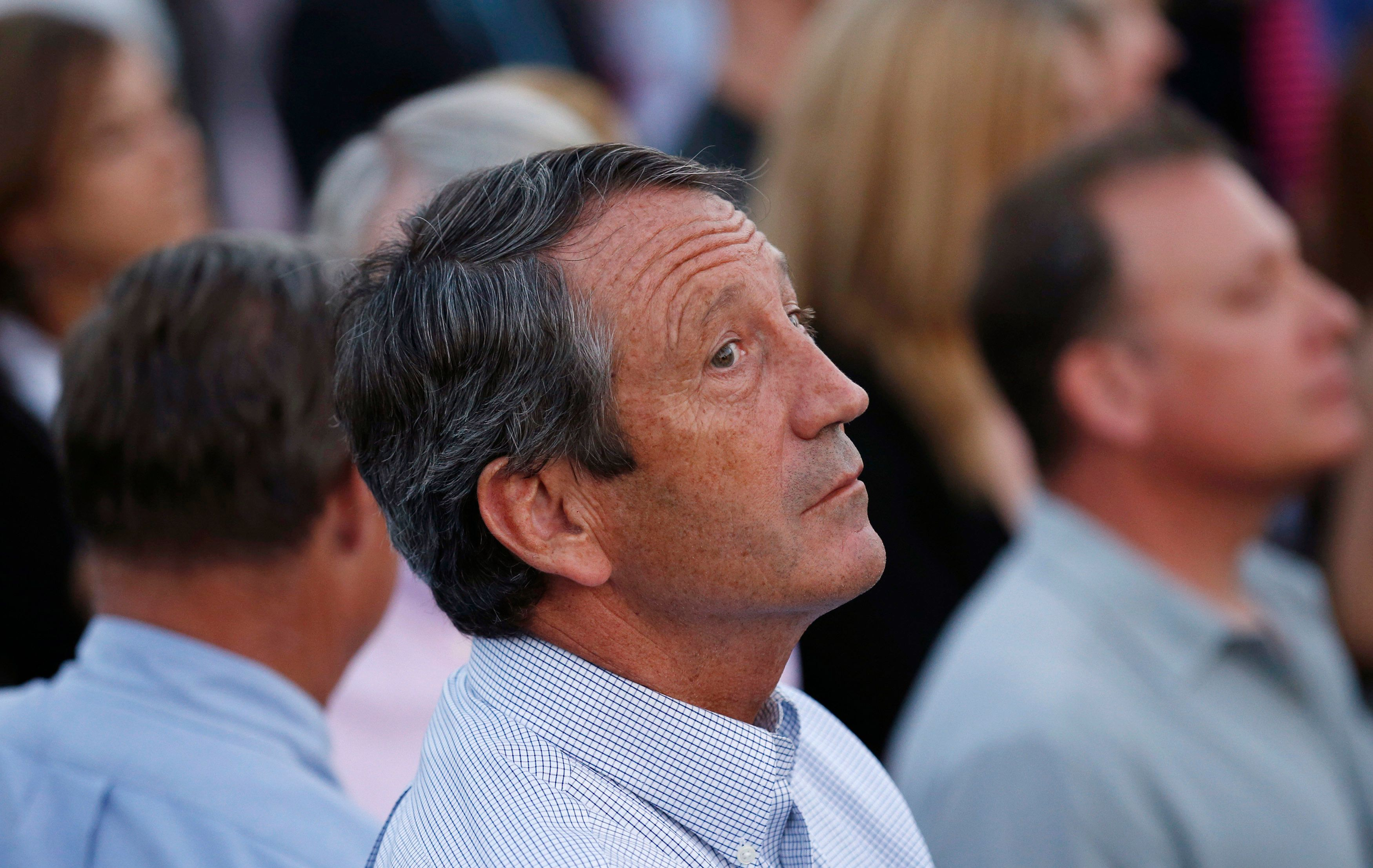 Rep. Mark Sanford (R-SC) looks up while attending a picnic for members of Congress hosted by U.S. President Barack Obama at the White House in Washington September 17, 2014. Sanford and his former wife have agreed to go to mediation over the latest spat arising from their divorce in 2010 after his extramarital affair while serving as the state's governor, a judge said on Monday.  REUTERS/Kevin Lamarque  (UNITED STATES - Tags: POLITICS)