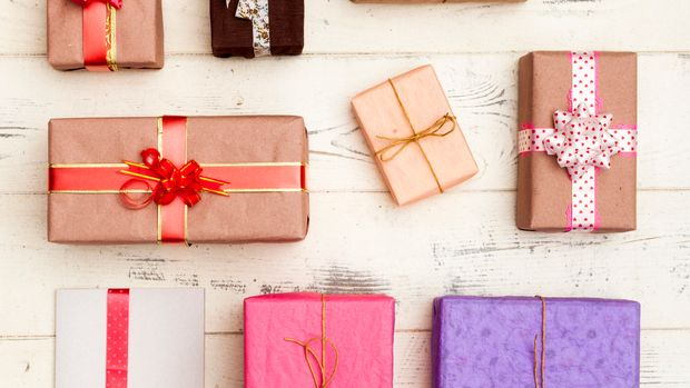 Wrapped gifts on wooden table