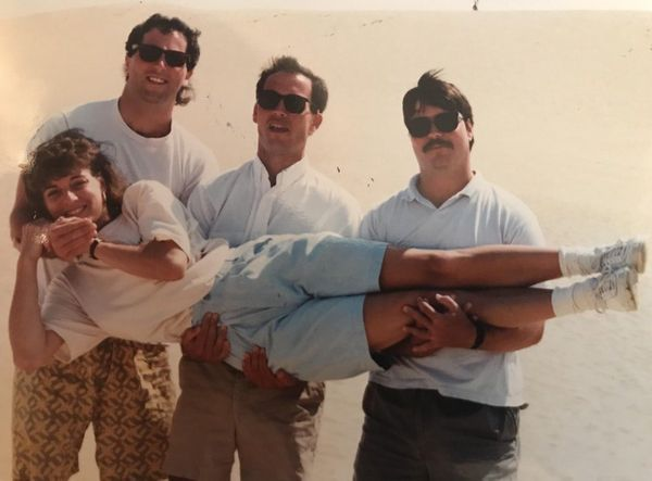 """My dad, Mark (center), and his brothers holding my mom, Tricia, on a family vacation in North Carolina. I've always lo"