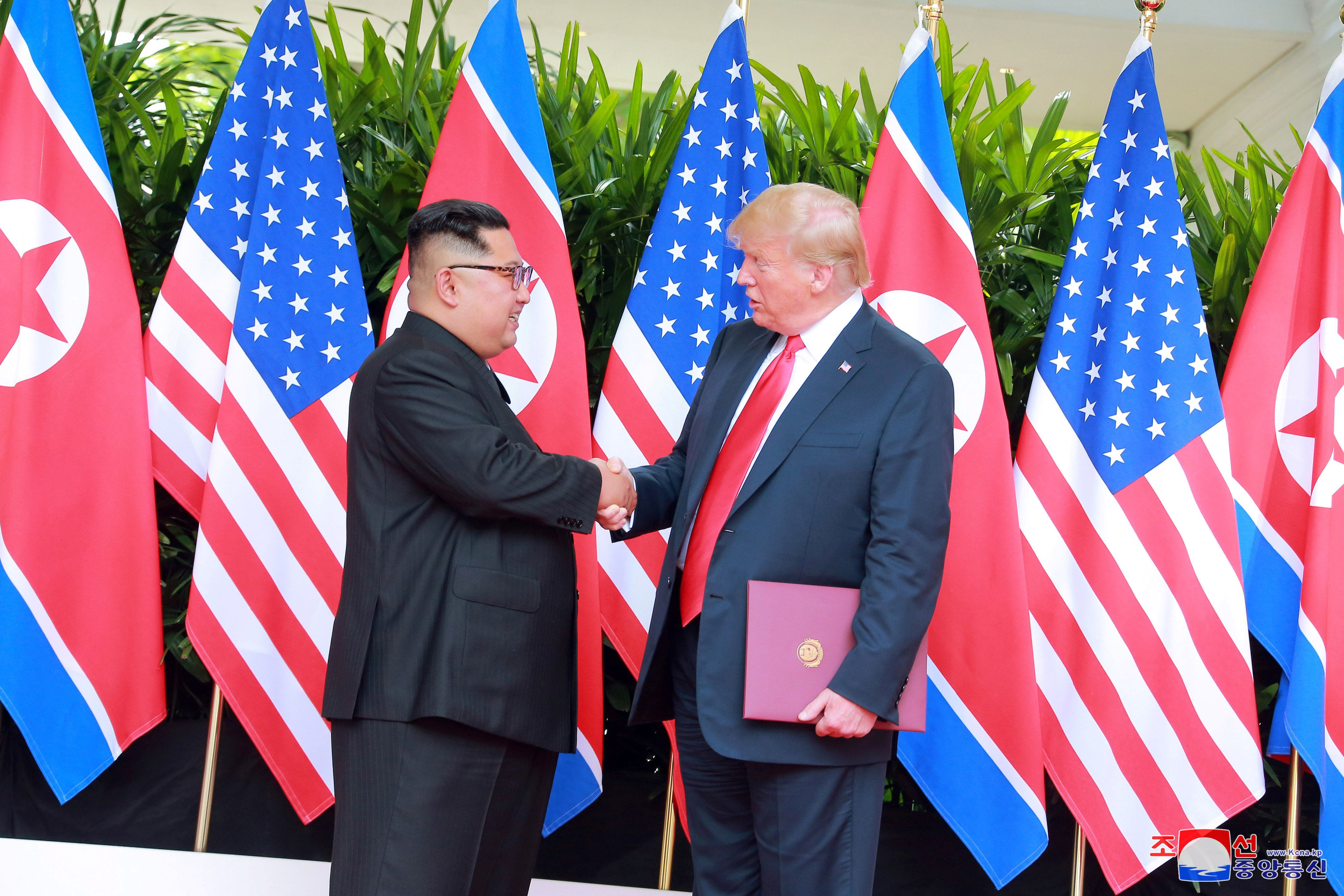 U.S. President Donald Trump shakes hands with North Korean leader Kim Jong Un at the Capella Hotel on...