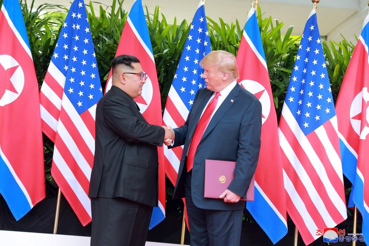 U.S. President Donald Trump shakes hands with North Korean leader Kim Jong Un at the Capella Hotel on Sentosa island in Singapore on Tuesday.