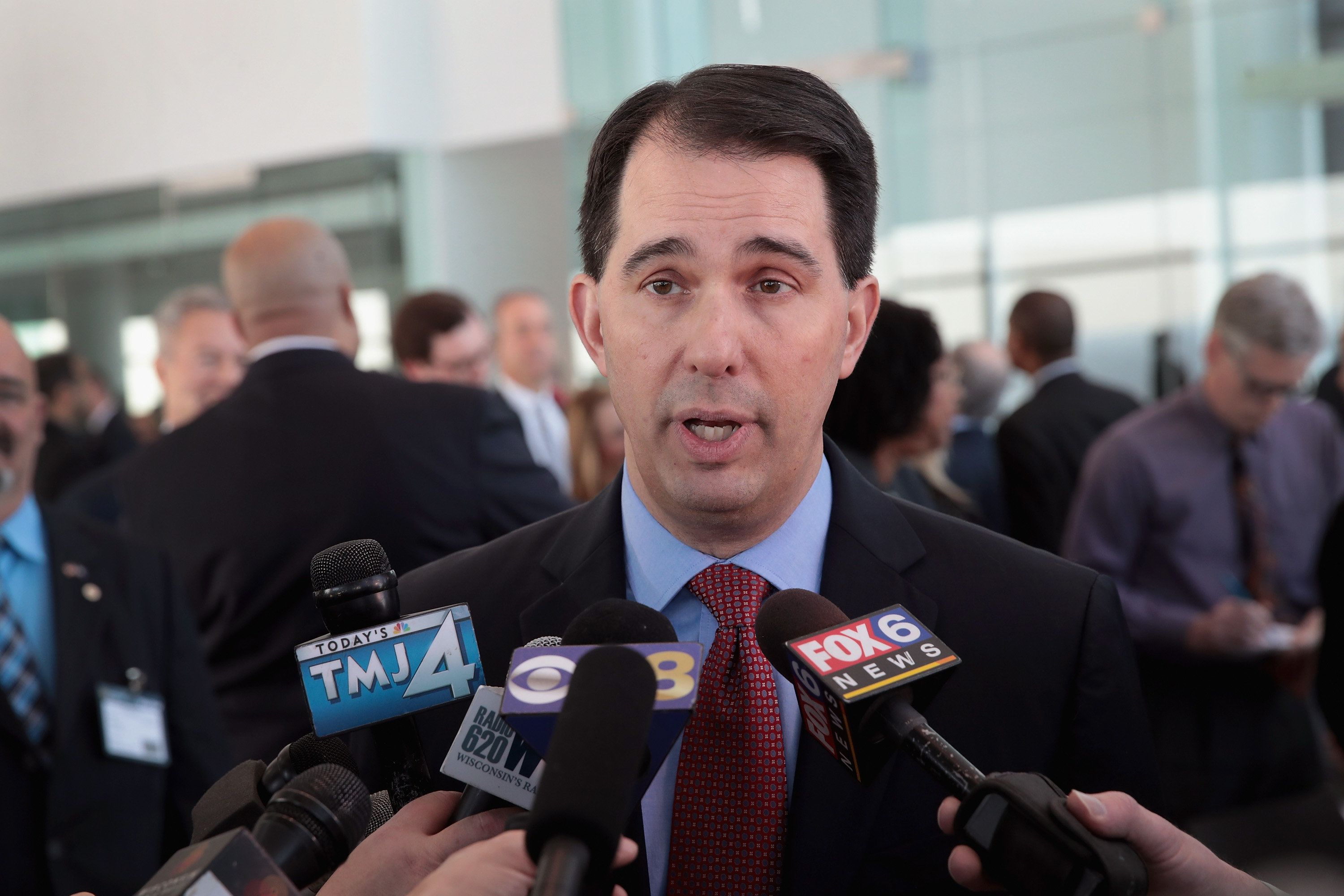 MILWAUKEE, WI - FEBRUARY 06:  Wisconsin Governor Scott Walker speaks to the press at an event held to announce Foxconn's plan to purchase an office building from Northwestern Mutual on February 6, 2018 in Milwaukee, Wisconsin. The building will be Foxconn's Wisconsin headquarters. Foxconn, which makes LCD screen panels, is building a $10 billion campus in Wisconsin.  (Photo by Scott Olson/Getty Images)