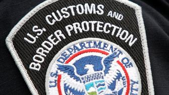 A U.S. Customs and Border Protection badge is seen on the shoulder of a customs agent following a signing agreement to make 'Shiprider', joint law enforcement teams stationed along the international maritime border, permanent during a media conference in Detroit, Michigan May 26, 2009.  REUTERS/Rebecca Cook  (UNITED STATES CRIME LAW POLITICS)