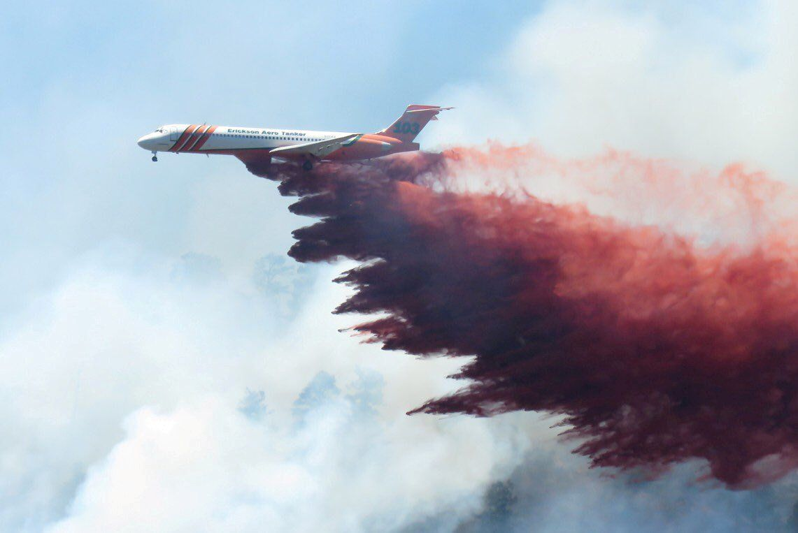 A plane drops fire-retardant chemicals on the 416 Fire near Durango, Colorado, U.S. in this June 9, 2018 handout photo. La Plata County/Handout via REUTERS  ATTENTION EDITORS - THIS IMAGE WAS PROVIDED BY A THIRD PARTY.