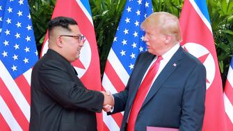 U.S. President Donald Trump shakes hands with North Korean leader Kim Jong Un at the Capella Hotel on Sentosa island in Singapore in this picture released on June 12, 2018 by North Korea's Korean Central News Agency. KCNA via REUTERS ATTENTION EDITORS - THIS PICTURE WAS PROVIDED BY A THIRD PARTY. REUTERS IS UNABLE TO INDEPENDENTLY VERIFY THE AUTHENTICITY, CONTENT, LOCATION OR DATE OF THIS IMAGE. NO THIRD PARTY SALES. NOT FOR USE BY REUTERS THIRD PARTY DISTRIBUTORS. SOUTH KOREA OUT. NO COMMERCIAL OR EDITORIAL SALES IN SOUTH KOREA.
