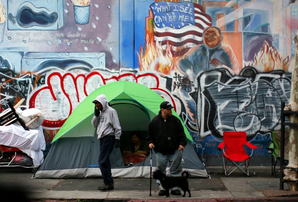 People wake up on Skid Row in downtown Los Angeles. The city is grappling with a serious homelessness problem.