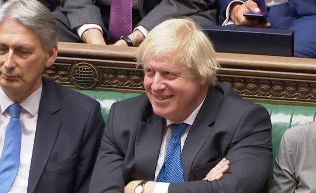 Boris Johnson chuckles as Jeremy Corbyn makes fun of Tory divisions on