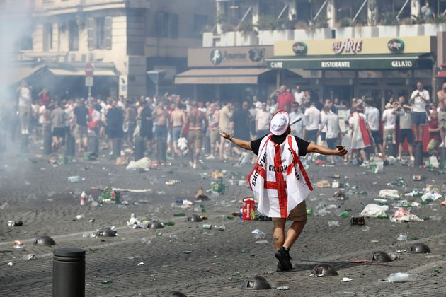 Police have confiscated the passports of hundreds of British football hooligans ahead of the World Cup;...