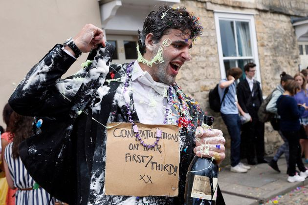 A student from University College Oxford gets 'trashed' after finishing his
