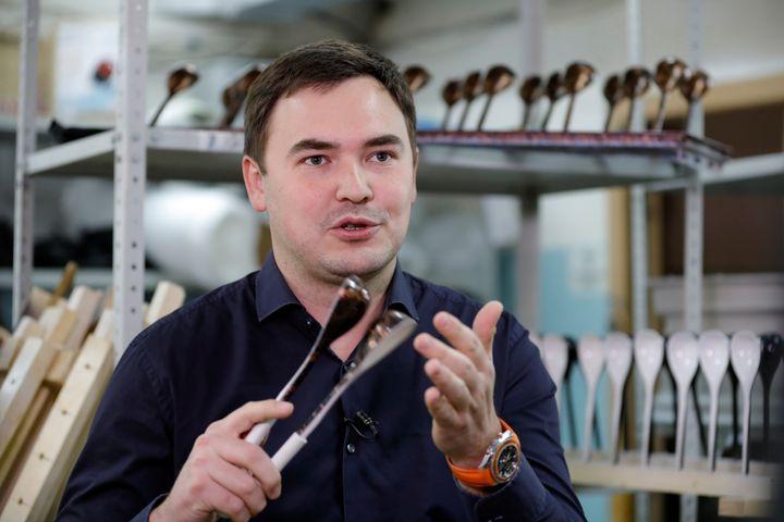 """Designer Rustam Nugmanov plays spoons branded """"Spoons of Victory"""""""