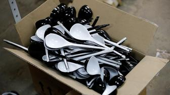 "Spoons branded ""Spoons of Victory"", official instrument chosen by Russia for the 2018 FIFA World Cup, are seen being prepared for colouring at a workshop of designer Rustam Nugmanov in the city of Lyubertsy, outside Moscow, Russia June 7, 2018. Picture taken June 7, 2018. REUTERS/Tatyana Makeyeva"