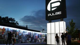 ORLANDO, FL - JUNE 11: People visit the memorial to the 49 shooting victims setup at the Pulse nightclub on June 11, 2018 in Orlando, Florida. On June 12, 2016 a mass shooting took place at the Pulse nightclub killed 49 people and wounded 53.  (Photo by Joe Raedle/Getty Images)