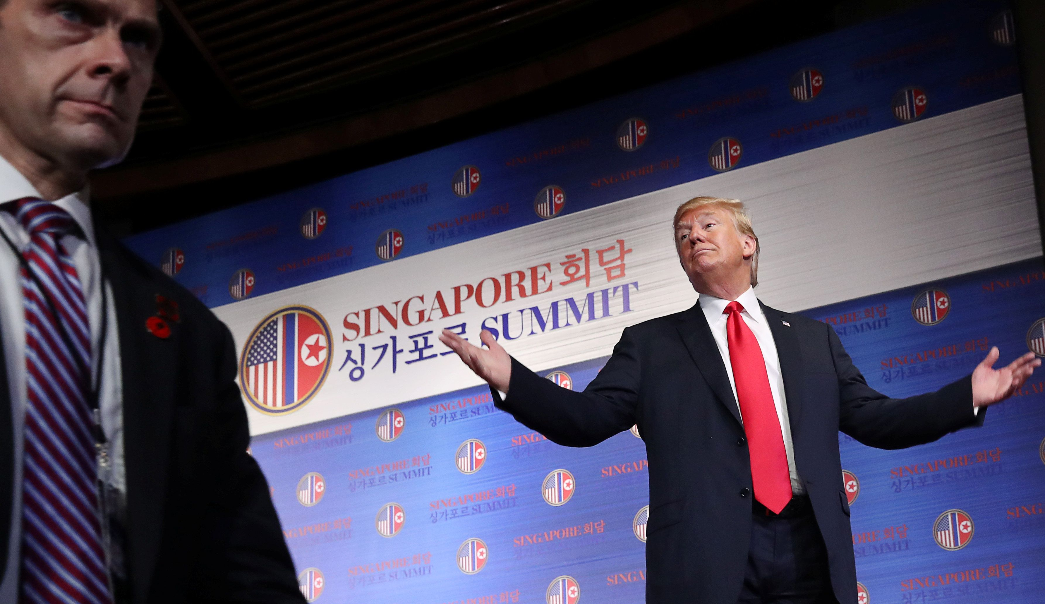 U.S. President Donald Trump reacts after a news conference after his meeting with North Korean leader Kim Jong Un at the Capella Hotel on Sentosa island in Singapore June 12, 2018. REUTERS/Jonathan Ernst